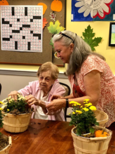 senior flower arranging
